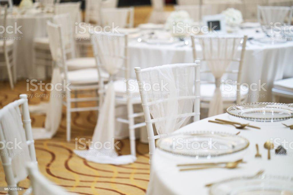 Back Side Of White Chiavari Chairs Arrangement For Wedding Reception