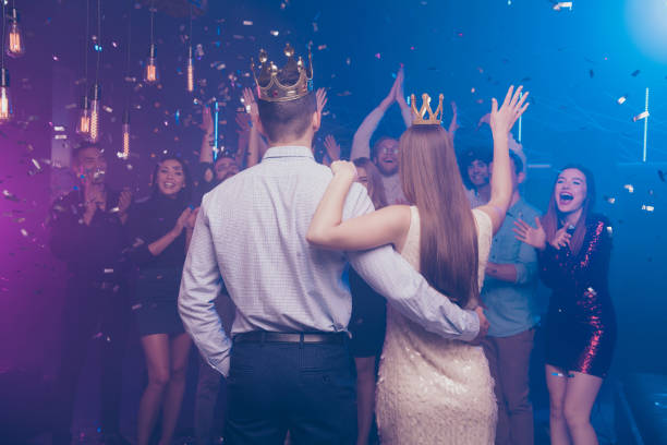 Back side view portrait of lovers have become king queen celebrating scream buddies enjoy dance floor Back side view portrait of lovers have become king queen celebrating scream buddies enjoy dance floor prom night stock pictures, royalty-free photos & images