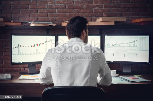 istock Back, spine view of trader man in work 1130771094