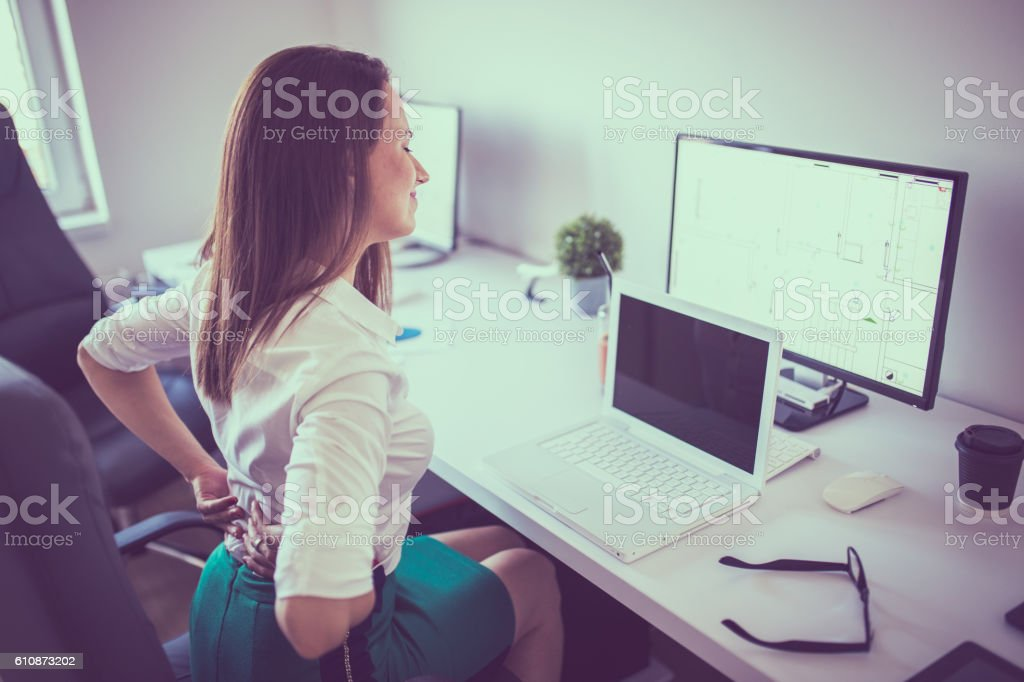 Back stiffness stock photo