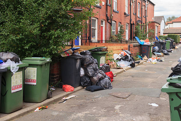 Back street full of rubbish and bins in Leeds stock photo
