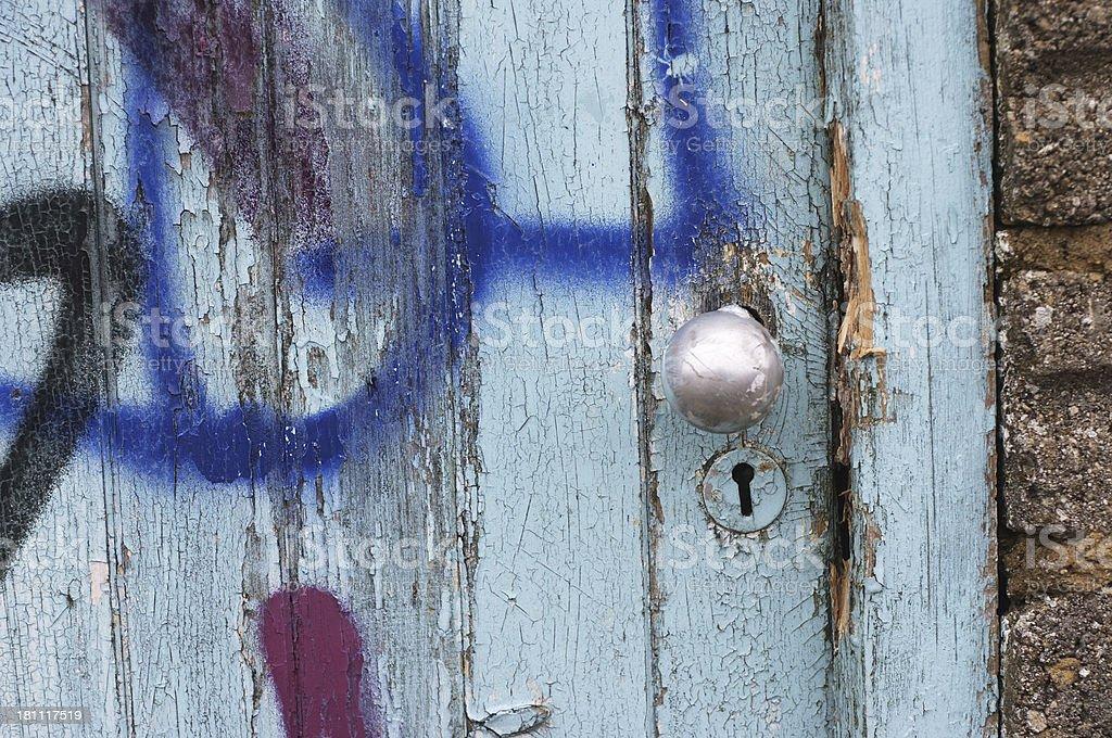 Urban graffiti on splintered wooden door stock photo