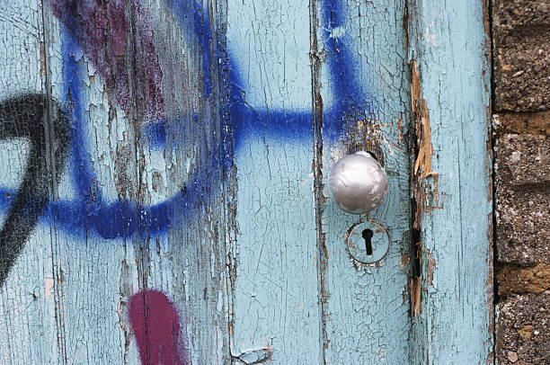 urban graffiti on splintered wooden door - whiteway graffiti stock photos and pictures