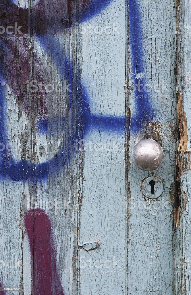 Graffiti door knob and keyhole stock photo