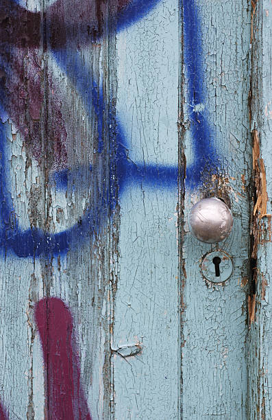 graffiti door knob and keyhole - whiteway graffiti stock photos and pictures