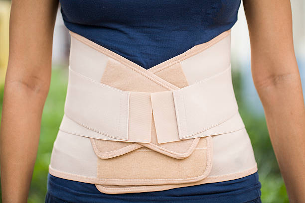 Back support for muscle back Back support for muscle back corset stock pictures, royalty-free photos & images