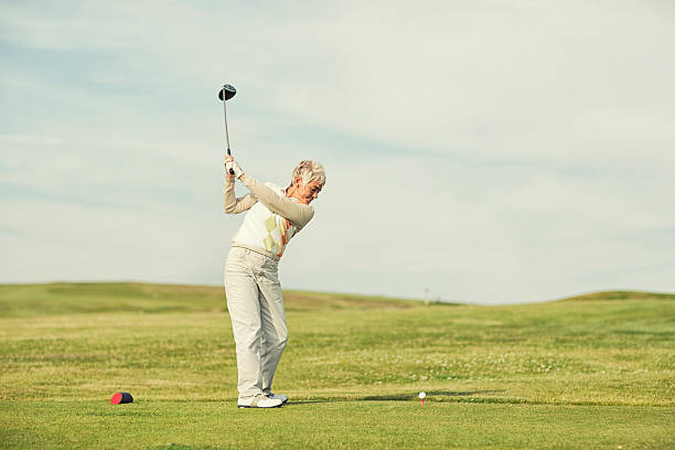 back swing - female golfer stock photos and pictures