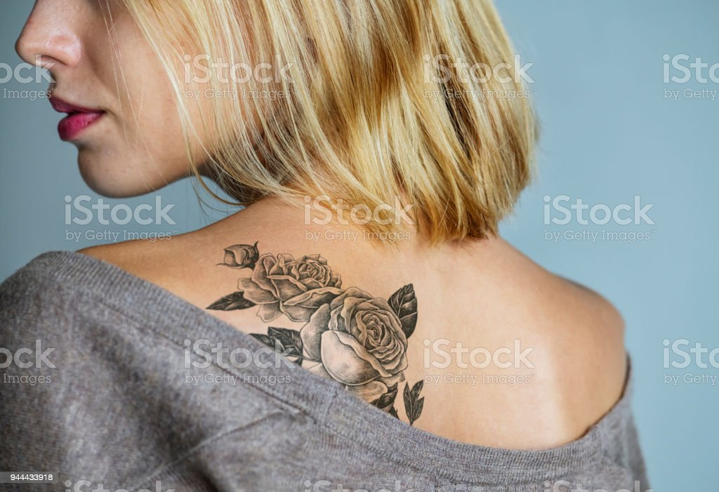 Back tattoo of a woman stock photo