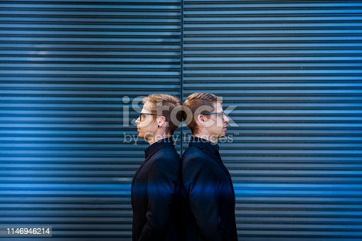 istock back to back, twin brothers portrait 1146946214