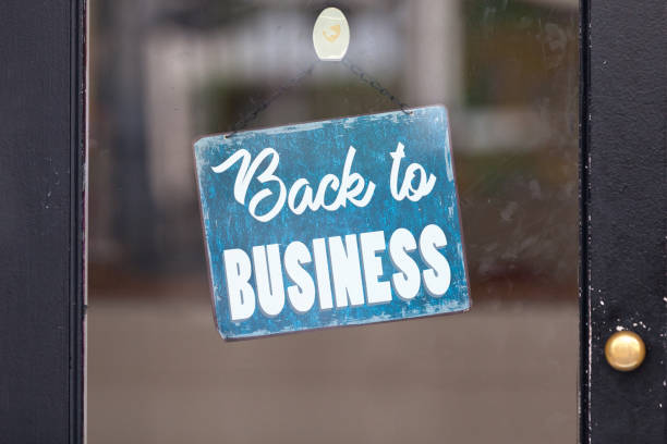 Back to business - Open sign stock photo