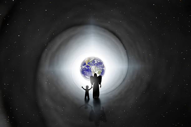 Back To Earth Reincarnation Concept The silhouette of an angel holding the hand of a child as she walks him back to earth in this reincarnation concept image.  Earth and stars provided by NASA. reincarnation stock pictures, royalty-free photos & images