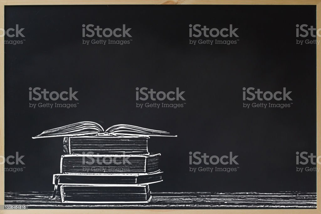 Back to school advertising sale concept : Black chalkboard frame with stacked and open books and copy space for text. Education background for display or wallpapers. Chalk board for education concept. stock photo