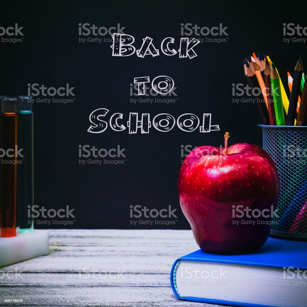 Back To School And Education Concept Classroom With Apple Books Pencils On Chalkboard