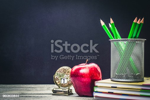 istock Back to School and Education concept. classroom with apple, books and pencils on chalkboard background. school border with copy space with school start calendar 960803844