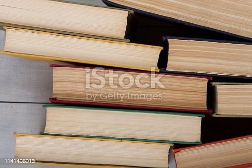 istock Back to school and education concept - top view of colorful hardback books on white wooden table 1141406013
