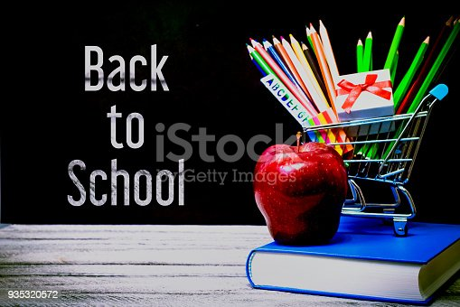 istock Back to School and Education shopping concept. classroom with apple, books and pencils on chalkboard background. greeting card 935320572