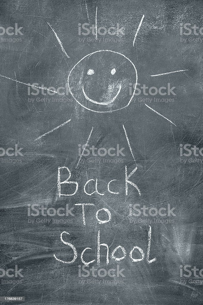 Back to school and happy sun on chalkboard royalty-free stock photo