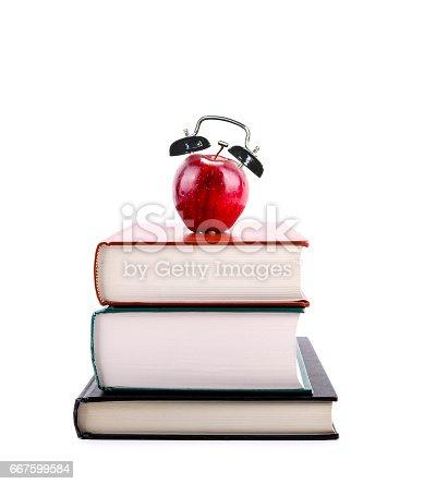 istock Back to School: Apple Alarm Clock on Stack of Books 667599584