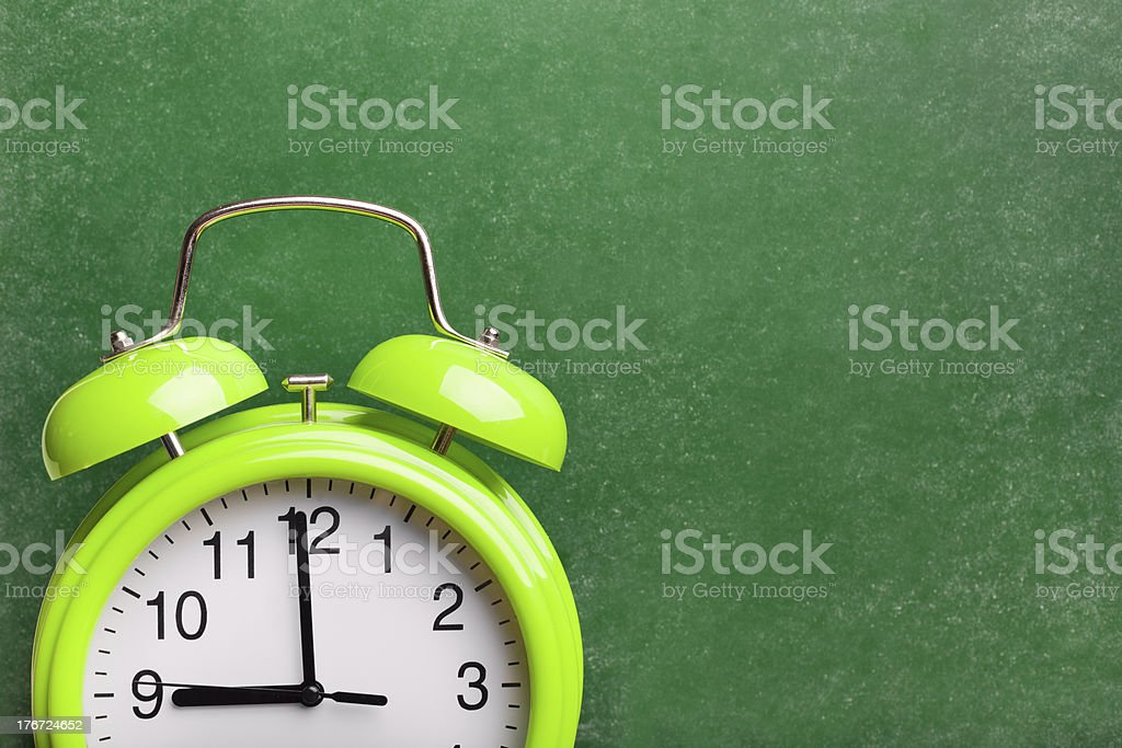 Back to school background with alarm clock royalty-free stock photo