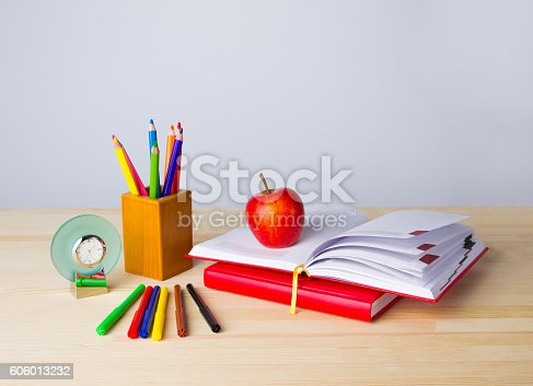istock Back to school background with books, pencils and apple over 606013232
