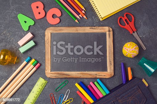 istock Back to school background with chalkboard and school supplies.View from above. Flat lay 825661772