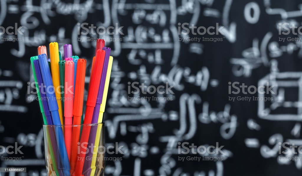 https www istockphoto com photo back to school background with colorful felt pens and blurred math formulas written gm1143568907 307156866