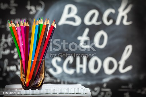 istock Back to school background with colorful pencils and the title Back to school written by white chalk on the black school chalkboard 1156137120