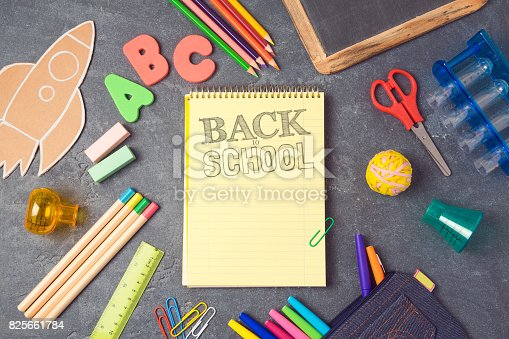 istock Back to school background with notebook and school supplies.View from above. Flat lay 825661784