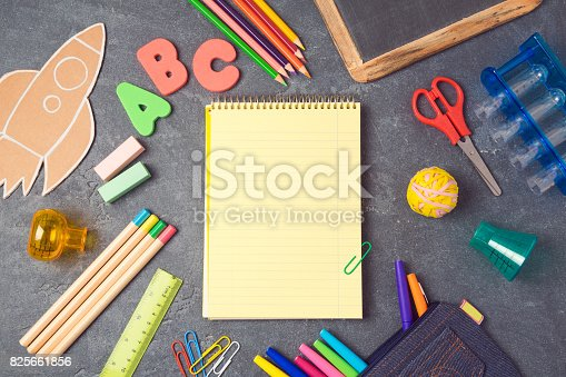 istock Back to school background with notebook and school supplies.View from above. Flat lay 825661856