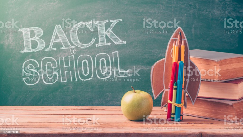 Back to school background with rocket stock photo