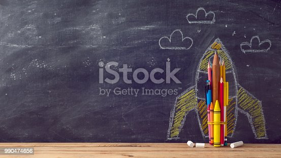 istock Back to school background with rocket 990474656