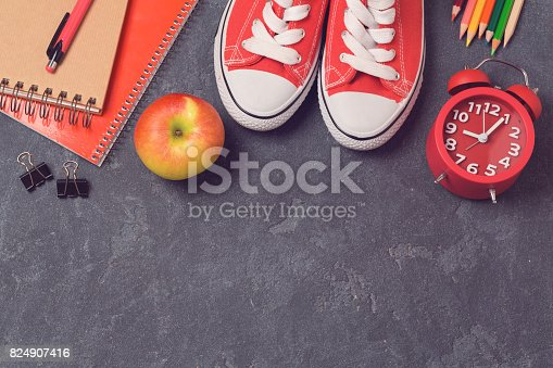 istock Back to school background with school supplies over blackboard. Top view. Flat lay 824907416