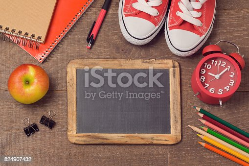 istock Back to school background with school supplies over wooden board. Top view. Flat lay 824907432
