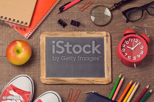 istock Back to school background with school supplies over wooden board. Top view. Flat lay 824907522