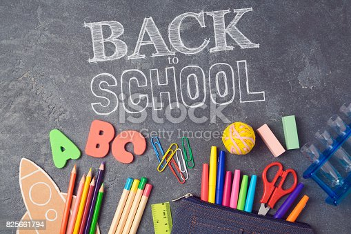 istock Back to school background with school supplies.View from above. Flat lay 825661794