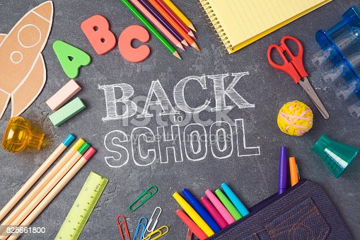 istock Back to school background with school supplies.View from above. Flat lay 825661800
