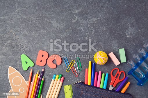 istock Back to school background with school supplies.View from above. Flat lay 825661804