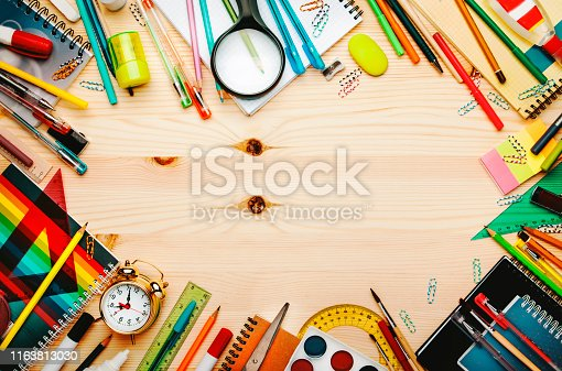 istock Back to school background with space for text, notebooks, pens, pencils, other stationery on light wooden school desk, education concept, flat lay, top view 1163813030
