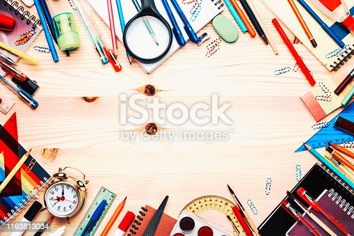 istock Back to school background with space for text, notebooks, pens, pencils, other stationery on light wooden school desk, education concept, flat lay, top view 1163813034