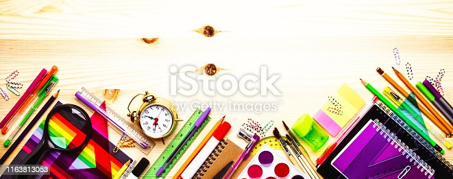 istock Back to school background with space for text, notebooks, pens, pencils, other stationery on light wooden school desk, education concept, flat lay, top view 1163813053