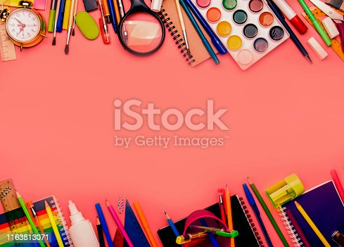 istock Back to school background with space for text, notebooks, pens, pencils, other stationery on pink modern background, education concept, flat lay, top view 1163813071