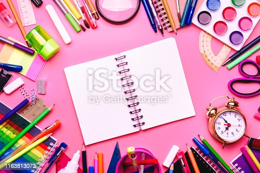 istock Back to school background with space for text, notebooks, pens, pencils, other stationery on pink modern background, education concept, flat lay, top view 1163813073