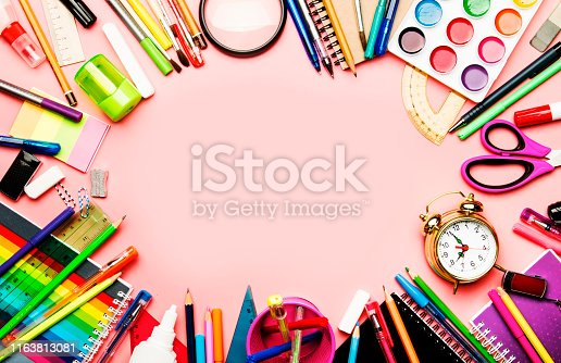 istock Back to school background with space for text, notebooks, pens, pencils, other stationery on pink modern background, education concept, flat lay, top view 1163813081