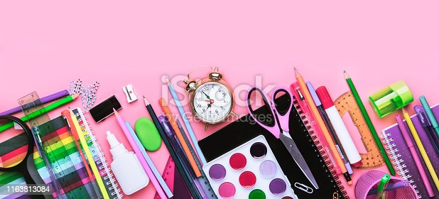 istock Back to school background with space for text, notebooks, pens, pencils, other stationery on pink modern background, education concept, flat lay, top view 1163813084