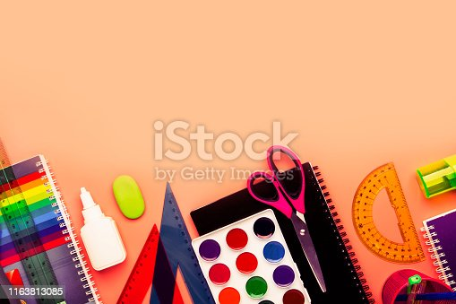istock Back to school background with space for text, notebooks, pens, pencils, other stationery on pink modern background, education concept, flat lay, top view 1163813085