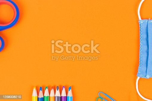 istock Back to school background with supplies and face mask, copy space. 1258008210