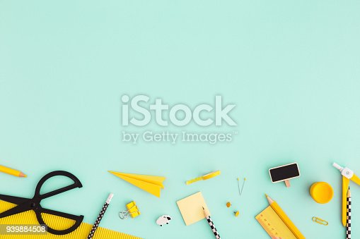 istock Back to school background with yellow school supplies Flat lay. 939884508