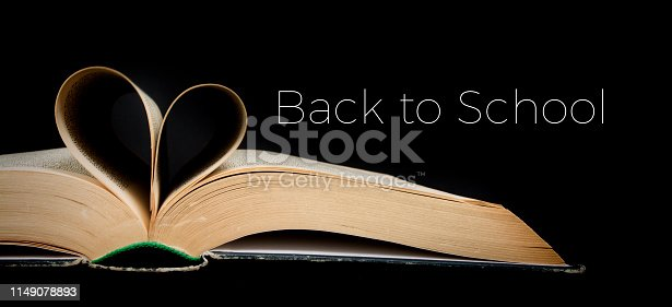 istock Back to school. Book sheets folded into a heart shape. Text. Love education, concept 1149078893
