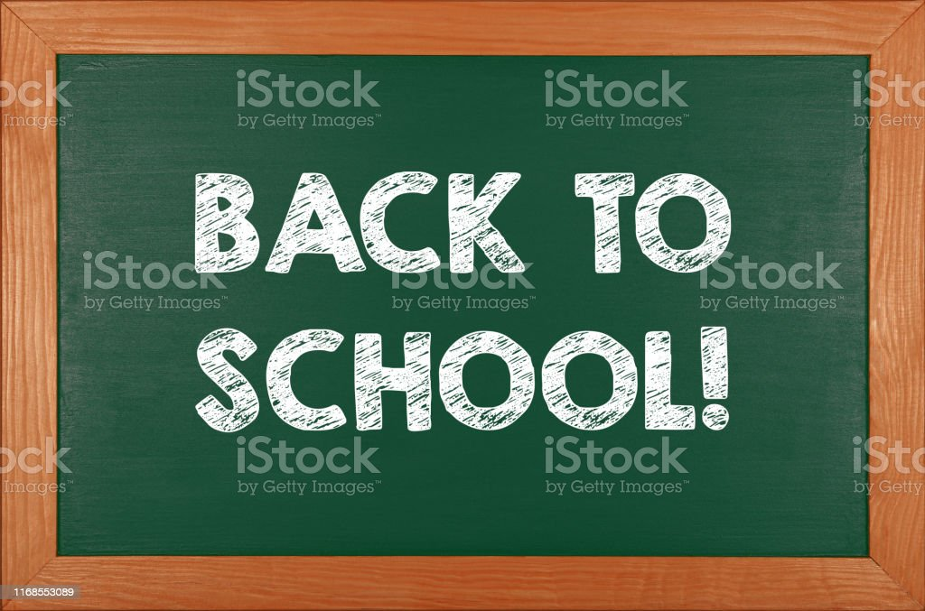 Back to school chalk handwritten sign over green chalkboard...