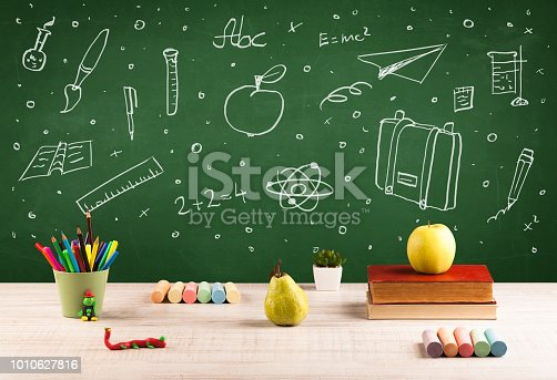 istock Back to school chalkboard and color pencils 1010627816